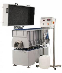 Machine à vibration pour traitement humide
